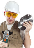 The man in working overalls in goggles and a helmet — Stock Photo