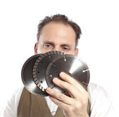 The man in working overalls with the detachable machine and saw disks — Stock Photo