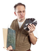 The man in working overalls chooses a detachable disk for the tool — Stock Photo