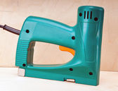 The tool - an electrical stapler for repair work — Stock Photo