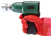 Hand in a working glove holds air impact wrench — Stock Photo