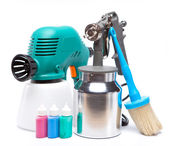The tool for a painting of surfaces - spray gun electrical and manual mechanical and small bottles with color — Stock Photo