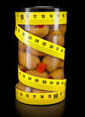 Olive and measuring tape- healthy food — Стоковое фото