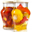 Stock Photo: Marinaded tomatoes, stuffed and bush pumpkins and vegetable marrows in glass jar