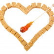 Heart from not refined reed sugar and candy sugar on stick — Stock Photo #33713041