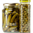 Glass jar with tinned capers and cucumber — Stock Photo #33713399