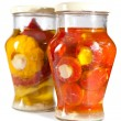Marinaded tomatoes, stuffed and bush pumpkins and vegetable marrows in a glass jar — Stock Photo