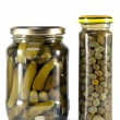 Glass jar with tinned capers and cucumber — Stock Photo