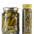 Glass jar with tinned capers and cucumber — Stock Photo #33714091