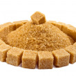 Cubes of sugar lie on circles and a heap of granulated sugar inside — Stock Photo