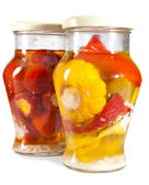 Marinaded tomatoes, stuffed and bush pumpkins and vegetable marrows in a glass jar — Photo