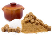 Granulated sugar refined and brown reed and a ceramic pan — Stock Photo