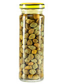 Glass jar with tinned capers — Stock Photo