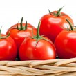 Stock Photo: Ripened tomatoes in wattled basket