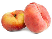 Flat peach on a white background — Stock Photo