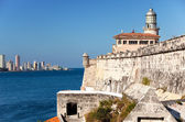 Havana. View of the old city through a bay from Morro's fortress. Panoram — Stock Photo