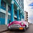 Old American retro car (50th years of the last century), an iconic sight in the city, on the Malecon street  — Stock Photo