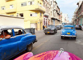 Old American retro cars, an iconic sight in the city, on the street January 27, 2013 in Old Havana, Cuba — Stock Photo