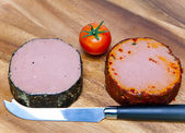 Two meat pastes, special knife and tomato — Stock Photo