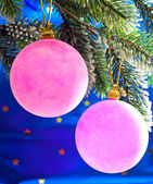 Pink New Year's balls on a branch of a Christmas tree — Stock Photo