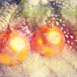 Two yellow New Year's balls,with a retro effect — Стоковая фотография