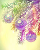 New Year's balls and snow-covered branches of a Christmas tree, with a retro effect — Stock Photo
