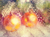 Two yellow New Year's balls,with a retro effect — Stock Photo
