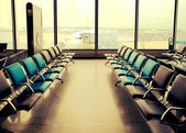 Empty armchairs in hall of airport ,with a retro effect — Stock Photo