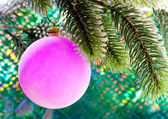 Pink New Year's balls on a branch of a Christmas tree — Photo