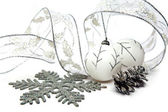 White New Year's balls and decorative tape on a white background — Stock Photo