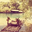 Raft on the bank of the  lagoon,with a retro effect — Stock Photo