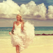 Bride on the tropical beach,with a retro effect — Stock Photo