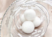 White fluffy New Year's balls and decorative tinsel — Stock Photo
