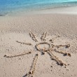 The sun - a picture on sand — Stock Photo