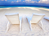 Beach chair on the seashore — Stock Photo