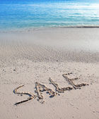 Text on sand - sale — Stock fotografie