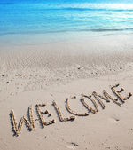 Inscription on sand- Welcome — Photo