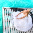 The bride on a wooden platform over the sea — Stock Photo