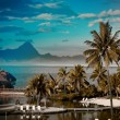 Stock Photo: Sunset over oceand mountain. Polynesia. Tahiti, with retro effect