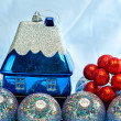 Blue New Year's ball and toy small house — Stock Photo