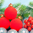 Red New Year's ball, decorative berries — Stock Photo