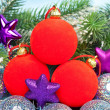 Red and silvery New Year's balls and branches with the snow — Stockfoto