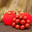 Red New Year's ball, decorative berries and tinsel — Stock Photo