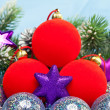Red and silvery New Year's balls and branches with the snow — Стоковая фотография
