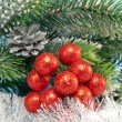 New Year's decorative berries and tinsel — Stock Photo