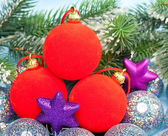 Red and silvery New Year's balls and branches with the snow — Stock Photo