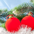 Red New Year's balls and branches with the snow — Stock Photo