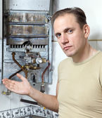 The man is upset, the gas water heater has broke — Stock Photo