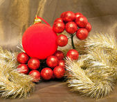 Red New Year's ball and tinsel — Stock Photo