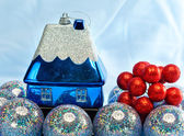 Blue New Year's ball and toy small house — Stok fotoğraf